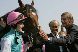 Frankel with trainer Sir Henry Cecil in the winners' enclosure